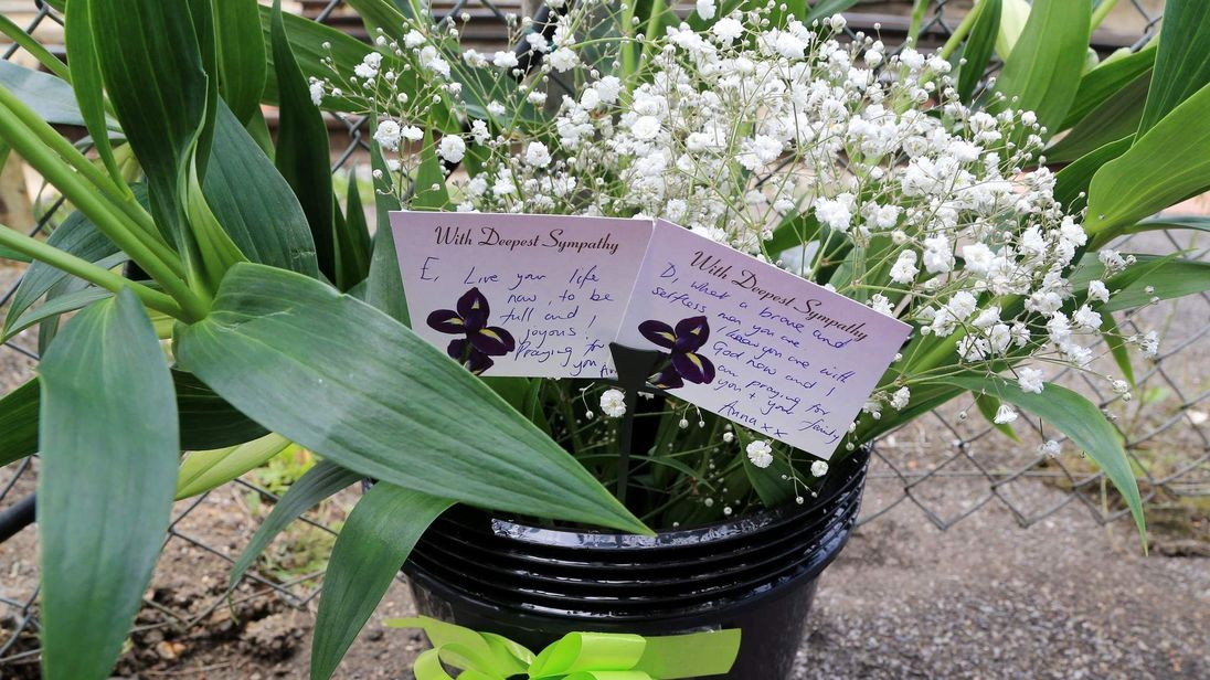Flowers left in memory at Chartham railway station in Kent