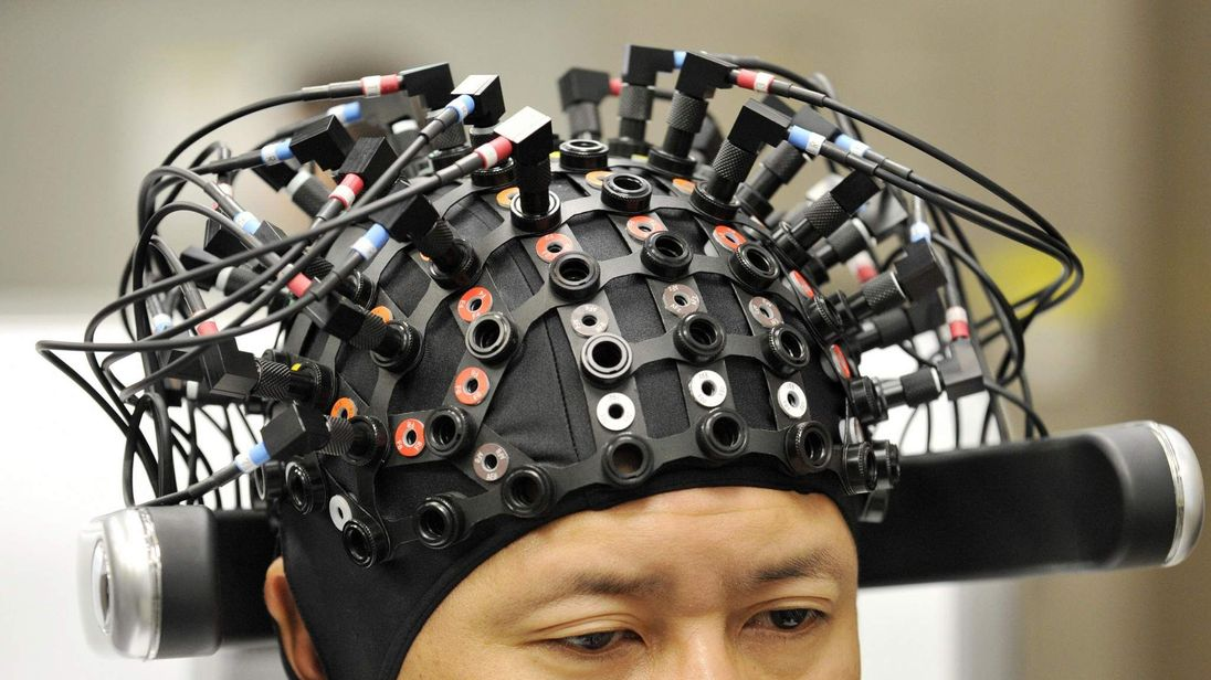 A man wears a brain-machine interface, e