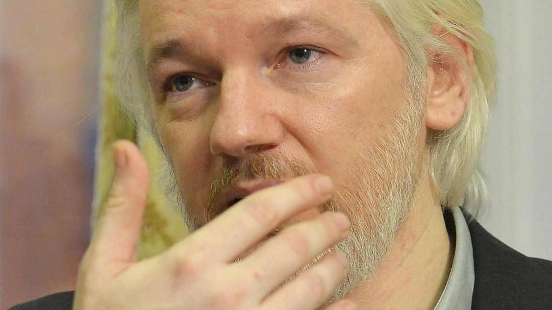 WikiLeaks founder Julian Assange gestures during a news conference at the Ecuadorian embassy in central London