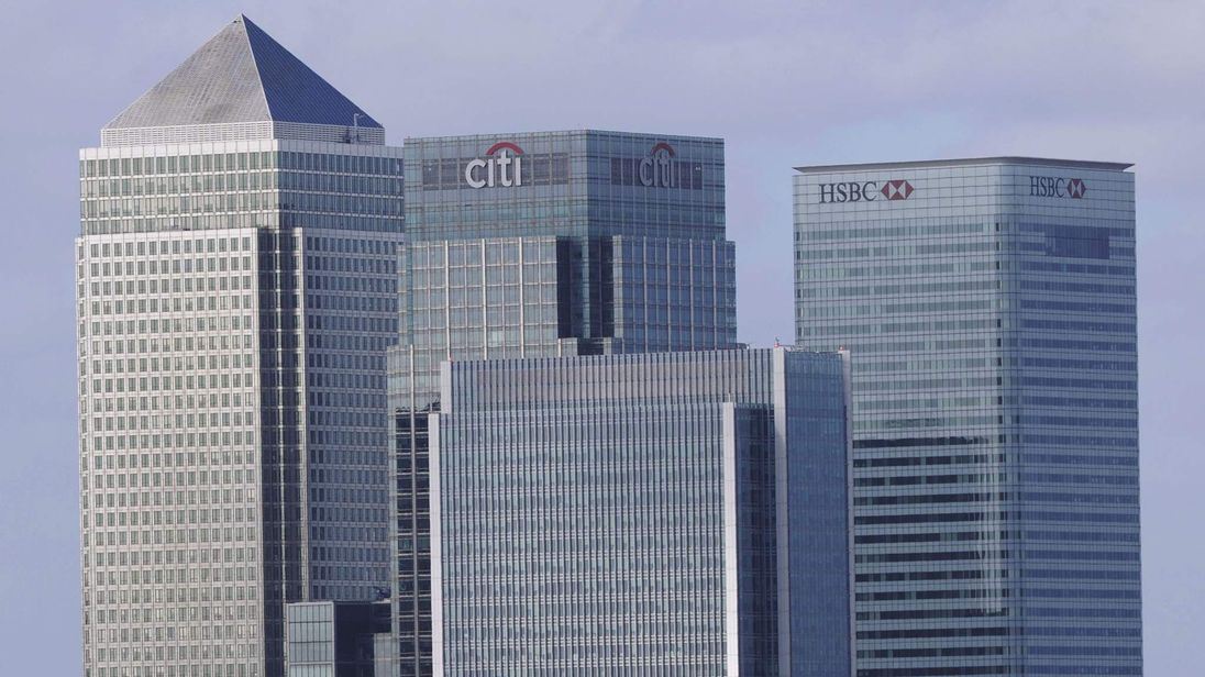 A general view of the London headquarters of British banks HSBC (R) and Barclays (L) is pictured at Canary Wharf