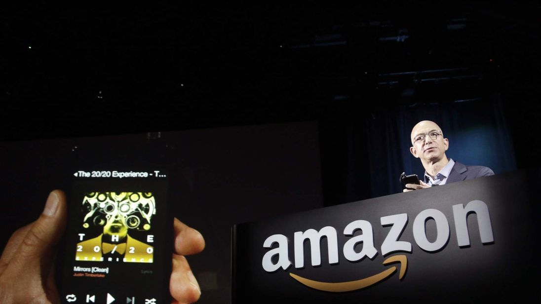 Amazon CEO Jeff Bezos shows off his company's new Fire smartphone in Seattle, Washington