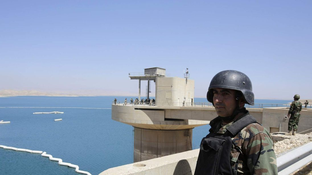 Peshmerga fighters stand guard at Mosul Dam in northern Iraq