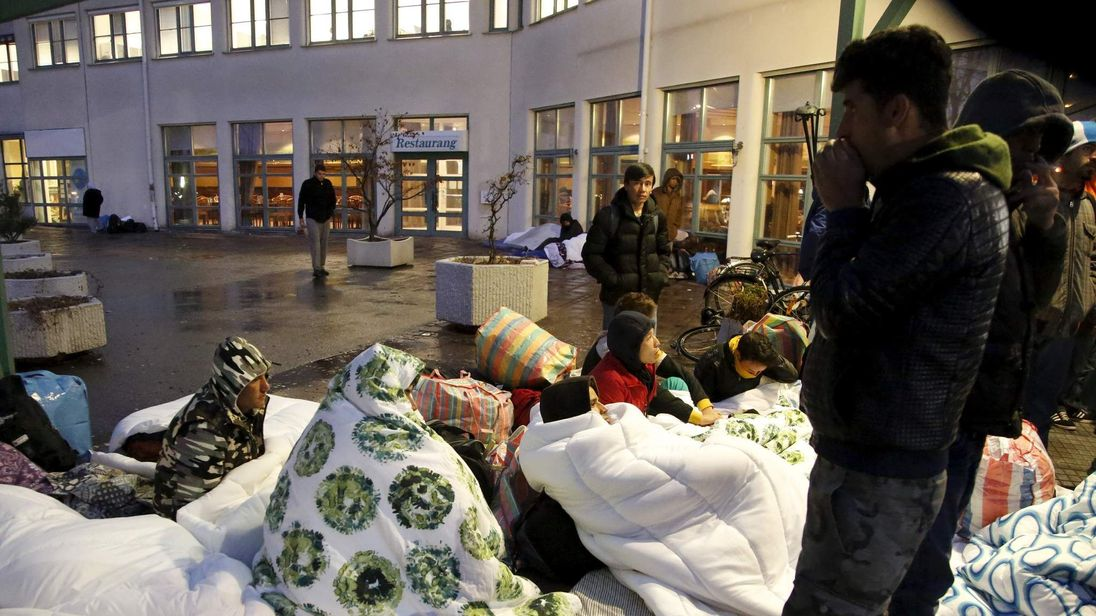 Refugees sleep outside the entrance of the Swedish Migration Agency's arrival center for asylum seekers at Jagersro in Malmo, Swede