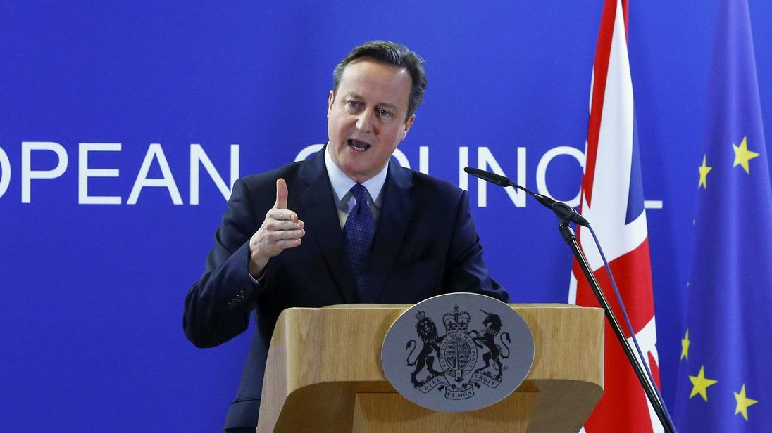 British Prime Minister David Cameron prepares to hold a briefing during a European Union leaders summit in Brussels