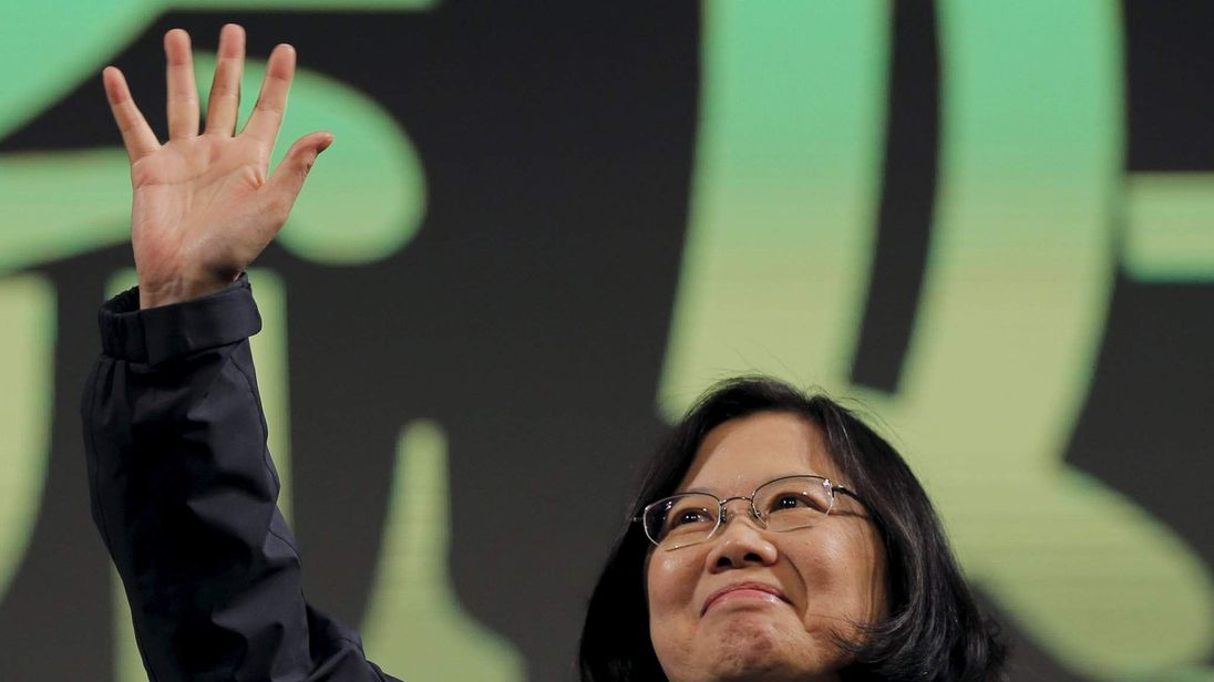 Democratic Progressive Party (DPP) Chairperson and presidential candidate Tsai Ing-wen waves to her supporters after her election victory at their party headquarters in Taipei