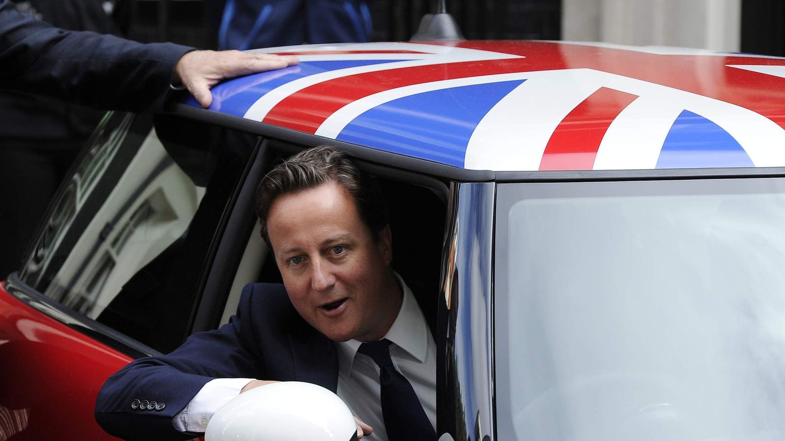David Cameron in the driving seat of a new Mini