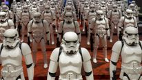 """Models of First Order's Stormtrooper Battle Buddy from the film """"Star Wars - The Force Awakens"""" are displayed in a shop in Shanghai"""
