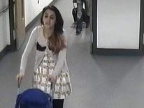 CCTV pic of Tareena Shakil at East Midlands Airport with her child