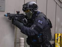 Armed police take part in a simulated attack.