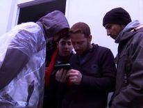 People looking at phone