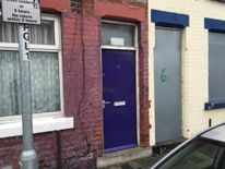 The door of an asylum seeker's house which has now been painted purple