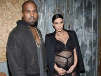 Kanye West (L) and television personality Kim Kardashian