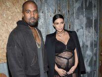 Kanye West (L) and television personality Kim Kardashian