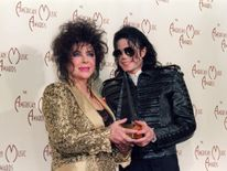 Elizabeth Taylor (L) with Michael Jackson