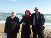 Bassel's parents and his wife on the beach