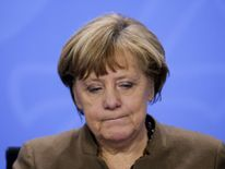 Angela Merkel reacts as she addresses a news conference after a meeting with state premiers at the Chancellery in Berlin
