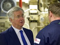 Defence Secretary Michael Fallon meets submariners at the base in Faslane near Glasgow
