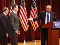 Republican US presidential candidate Trump introduces his Republican presidential candidate rivals Huckabee and Santorum at his veteran's rally in Des Moines