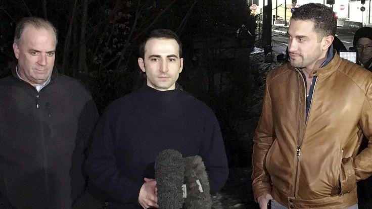 Amir Hekmati, flanked by U.S. Congressman Dan Kildee and brother-in-law Ramy Kurdi, speaks with media in Landstuhl