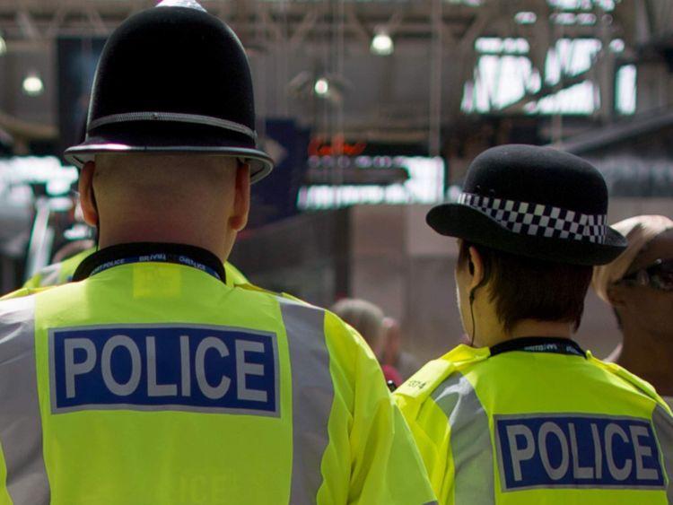 Policemen patrol