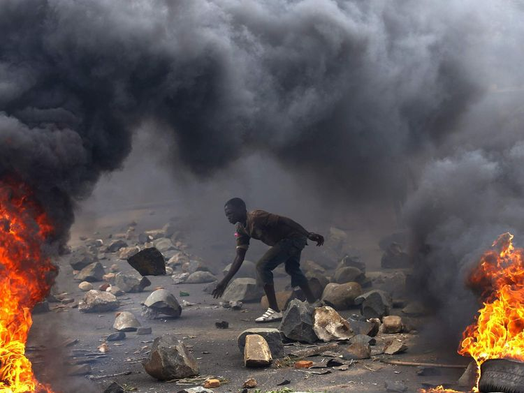 A protester sets up a  barricade during a protest against Burundi President Nkurunziza in Bujumbura