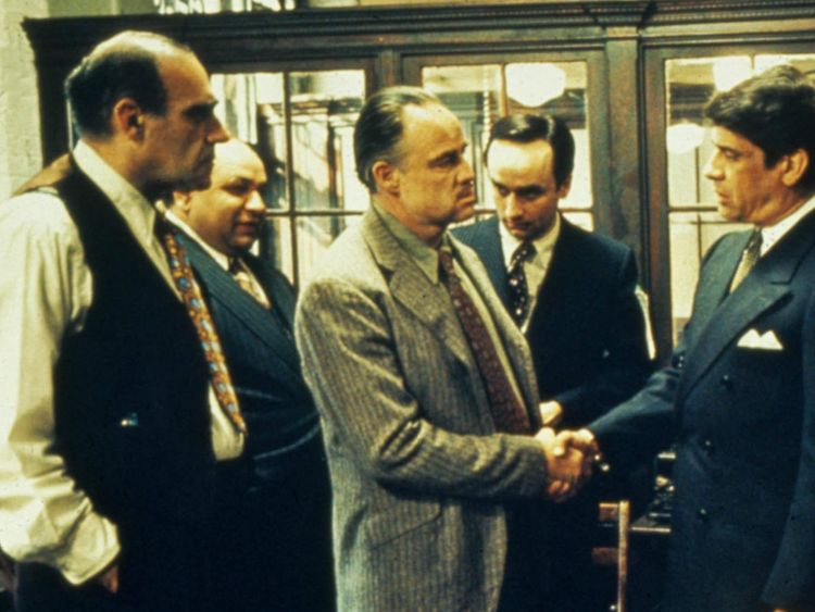 Abe Vigoda (Left) and Marlon Brando (centre)