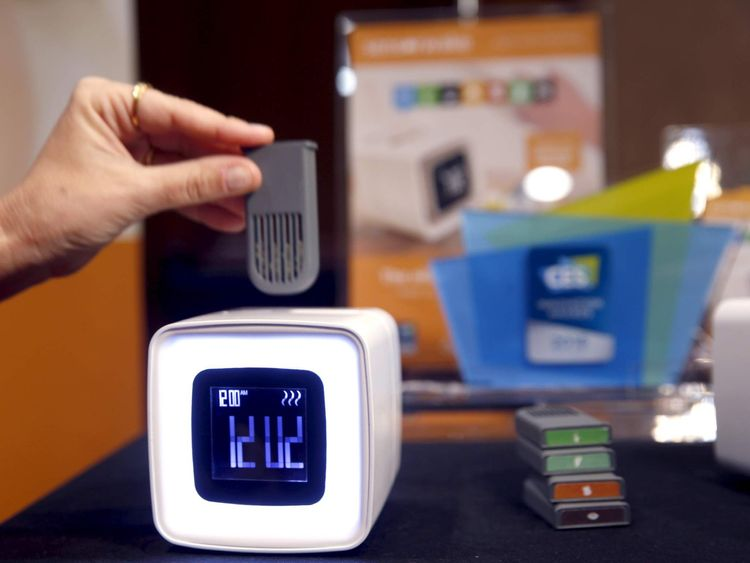 "An aroma module is inserted into a Sensorwake alarm clock during ""CES Unveiled,"" a preview event of the 2016 International CES trade show, in Las Vegas"