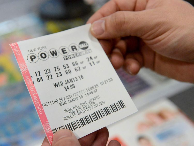 A person holds a Powerball ticket in New York