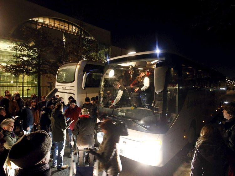 A bus with refugees from the Bavarian town of Landshut is pictured after its arrival to the Chancellery building in Berlin