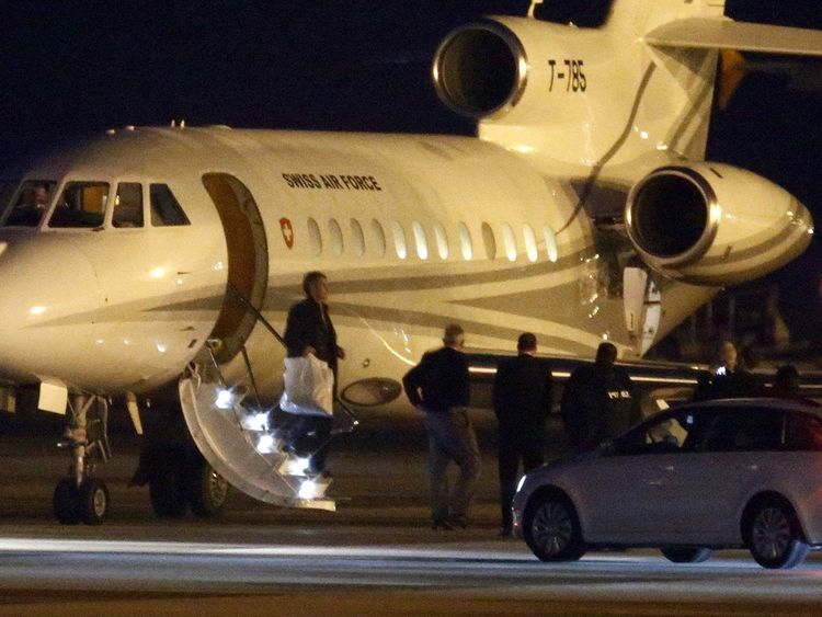 People walk off a plane carrying three Iranian-Americans, who left Tehran under a prisoner swap, after it landed at Cointrin airport in Geneva