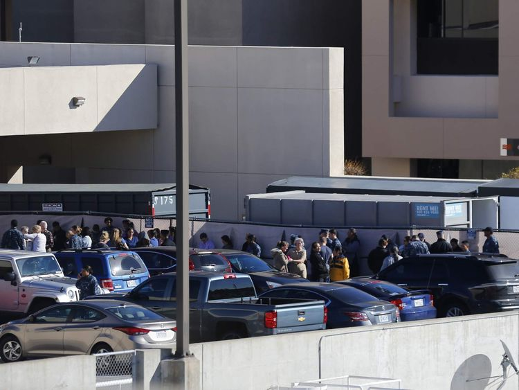 People are evacuated from a building at the Naval Medical Center in San Diego