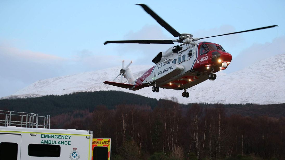 A casualty arrives by a search and rescue helicopter after an avalanche in the Creag Meagaidh area near Fort William