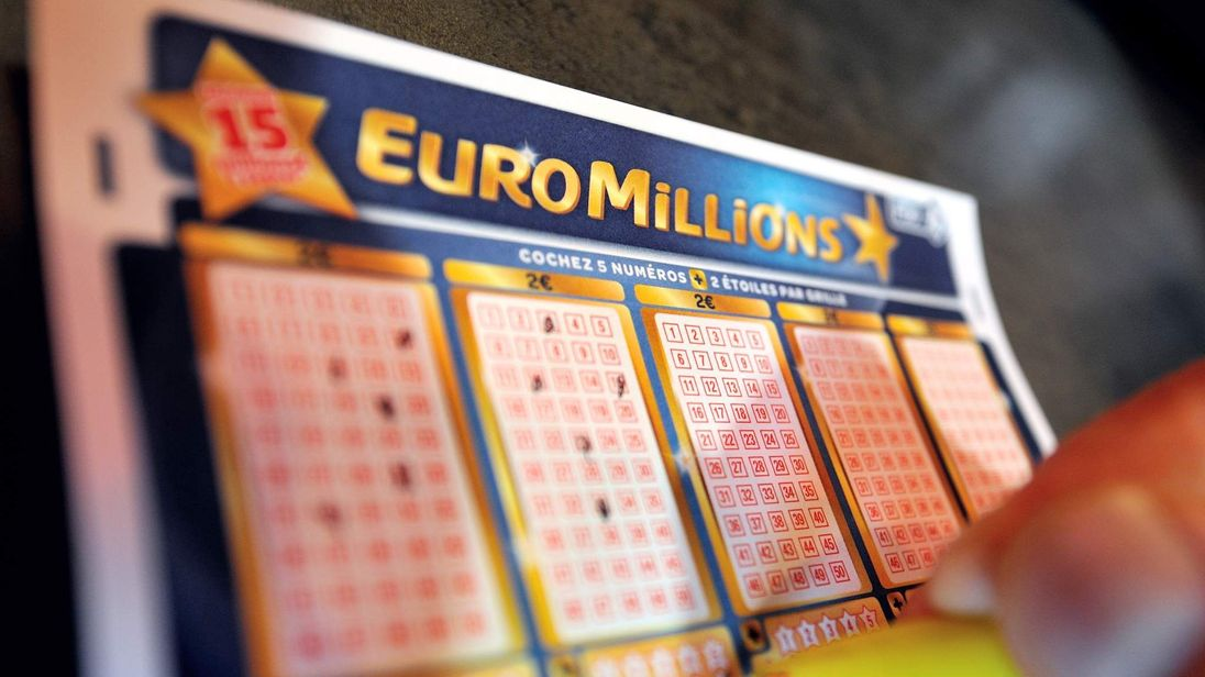 A person files a EuroMillions lottery grid on August 7, 2012, in the northern French city of Lille.