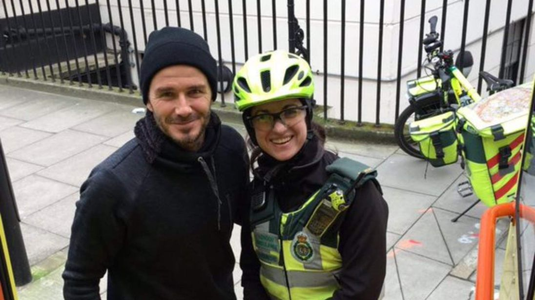 010216 David Beckham with paramedic after stopping to help in central London