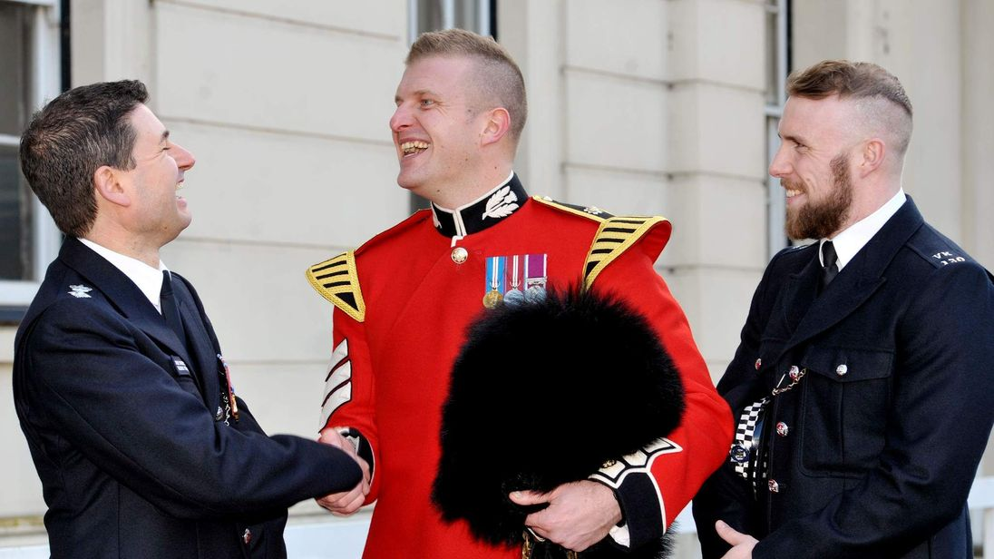 Lance Sergeant Matthew Lawson (centre) is thanked by Chief Superintendent Glenn Tunstall (left) of the Metropolitan Police and PC Brendan Dexter-Beek.