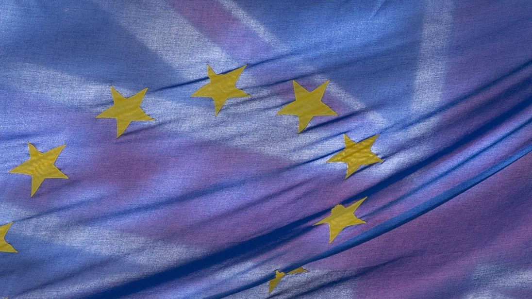 The Union Flag flies behind the European Flag outside the European Commission building in central London