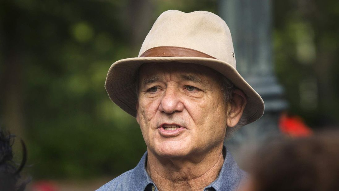 Actor Bill Murray takes part in a poetry reading and walk over the Brooklyn Bridge in New York