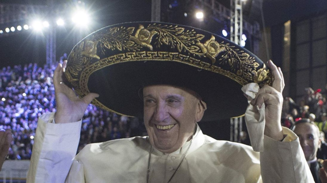 Pope Francis wears a sombrero hat as he  meets Mexico's President Enrique Pena Nieto and first lady Angelica Rivera after his arrival in Mexico City