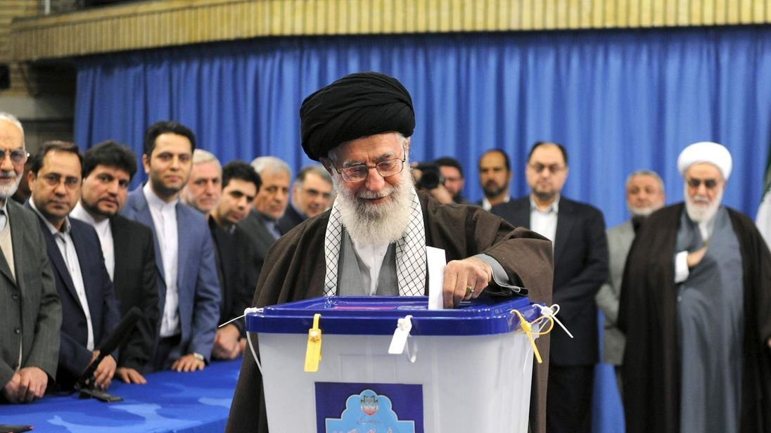 Iran's Supreme Leader Ayatollah Ali Khamenei casts his vote during elections for the parliament and Assembly of Experts, in Tehran