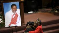 Janet Cooksey, is embraced as she attends the funeral for her son Quintonio LeGrier in Chicago