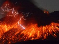 Volcanic lightning is seen at an eruption of Mount Sakurajima, in this photo taken from Tarumizu city, Kagoshima prefecture, southwestern Japan