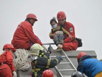 A child is rescued from a collapsed building in Tainan