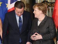 British Prime Minister David Cameron (L) and German Chancellor Angela Merkel.