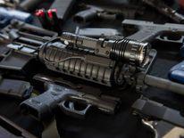 Firearms and training guns including an AR-15 rifle