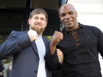 Ramzan Kadyrov poses with Mike Tyson during a trip the American boxer made to Chechnya