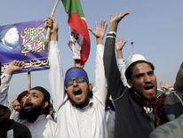 Supporters of a religious political party shout slogans