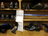 "Shoes removed by visitors out of reverence sit on a shelf marked ""reserved"" prior to remarks by Obama at the Islamic Society of Baltimore mosque in Catonsville, Maryland"