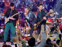 Chris Martin, lead singer of Coldplay, performs with the band during the half-time show at the NFL's Super Bowl 50 between the Carolina Panthers and the Denver Broncos in Santa Clara