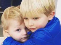 Sami Dawson son of Matt Dawson gets a hug from older brother Alex