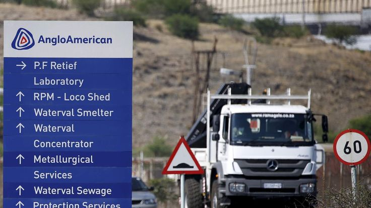 A truck drives past an AngloAmerican sign board at the company refinery, outside Rustenburg, northwest of Johannesburg